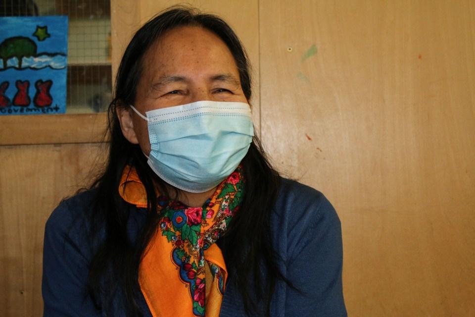 Rosa Mantla, a Tłı̨chǫ Elder, interpreted at a vaccine clinic in Wekweètì