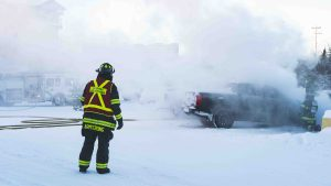 Yellowknife firefighters extinguish a truck fire at 99 Niven Drive on January 21, 2021. Sarah Pruys/Cabin Radio