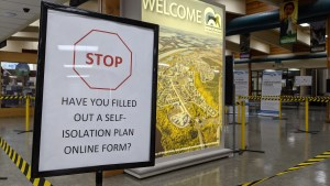 A sign at Inuvik's airport instructs people to fill out a self-isolation plan on arrival from outside the NWT