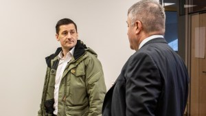 Kenny Ruptash, left, speaks to David Connelly at an event in February 2021