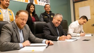 From left: Paul Gruner, David Connelly and Kenny Ruptash sign an agreement related to mining at the Nechalacho rare earths site