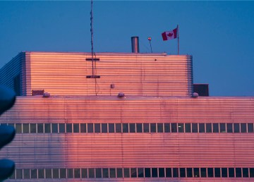 A Canadian flag flies atop Yellowknife's courthouse