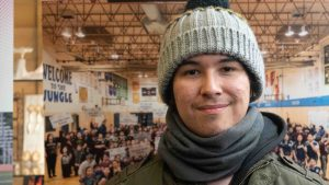 Cameron Enzoe, 19, makes muskox pizzas in Łútsël K'é. Sarah Pruys/Cabin Radio