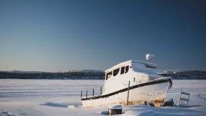 A file photo of a boat in Łútsël K'é in February 2021. Sarah Pruys/Cabin Radio