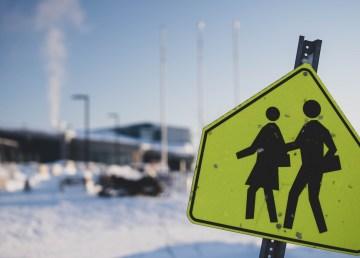 A file photo a school crossing sign in Łútsël K'é in February 2021. Sarah Pruys/Cabin Radio