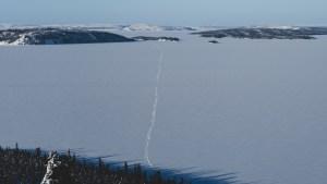 A file photo of a snowmobile trail heading toward Yellowknife from Łútsël K'é in February 2021. Sarah Pruys/Cabin Radio