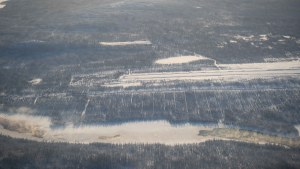 A file photo of the Snowdrift River beside the Łútsël K'é Airport in February 2021. Sarah Pruys/Cabin Radio