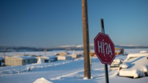 A file photo of a stop sign in Łútsël K'é in February 2021. Sarah Pruys/Cabin Radio