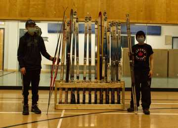 Students in Ulukhaktok stand beside some of the equipment for their new ski team