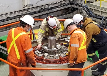 Workers inspect the Snare Rapids hydro unit on February 4, 2021 in an NWT Power Corporation handout image