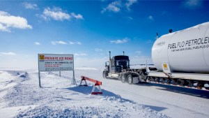A load enters the Nechalacho ice road in March 2021