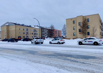 Police vehicles outside Yellowknife's Sandstone Apartments on April 7, 2021