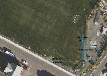 An aerial photo annotated by the Yellowknife Bay Soccer Club outlines the planned location of its proposed facilities
