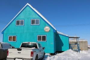 A file photo of the Tuktoyaktuk Community Corporation building in April 2021. Meaghan Brackenbury/ Cabin Radio