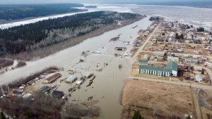 Floodwater covers a runway next to the village of Fort Simpson on May 9, 2021