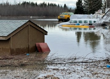 An aircraft sits partially submerged during flooding in Fort Simpson on May 8, 2021