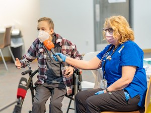 Riley Oldford, left, talks to reporters after becoming the first Yellowknife teenager to receive the Pfizer-BioNTech vaccine on May 6, 2021
