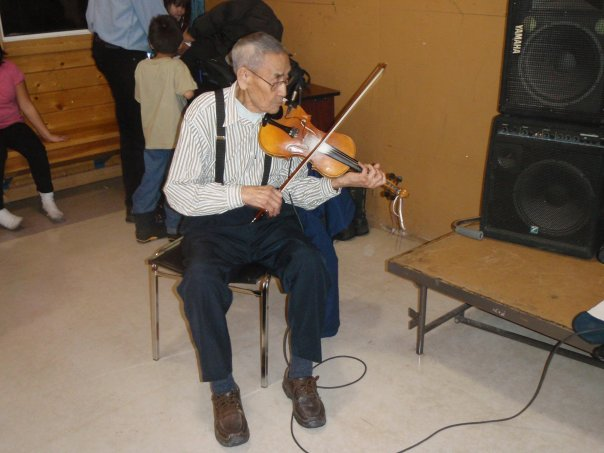 Maurice Lockhart playing fiddle at his 99th birthday party