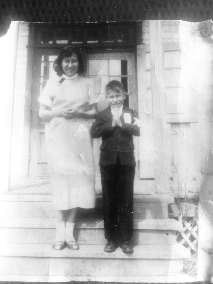 Shawna Yamkovy's mother, Emerence, and uncle Felix Lockhart on the front steps of St Joseph's residential school in Fort Resolution