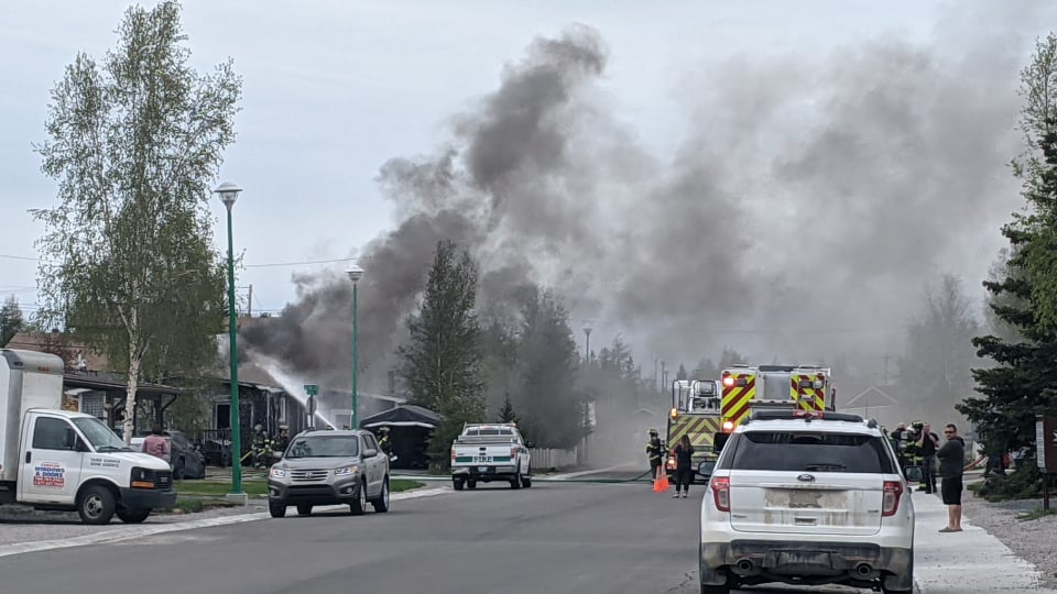Smoke is seen from a house fire in Yellowknife's Range Lake on June 10, 2021
