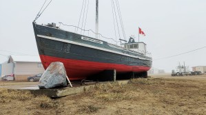 The ship Our Lady of Lourdes rests in Tuktoyaktuk