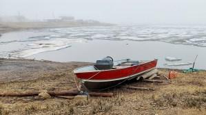 A boat next to the Arctic Ocean in Tuktoyaktuk