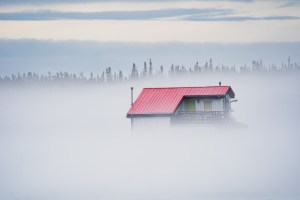 A houseboat in the mist on June 1, 2021