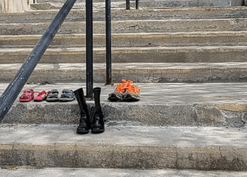 Shoes left on the steps of the St Joseph's Cathedral Parish in Fort Smith were removed - and then returned - on Tuesday afternoon