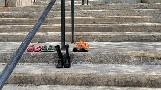 Shoes left on the steps of the St. Joseph's Cathedral Parish in Fort Smith were removed - and then returned - on Tuesday afternoon. Photo: Briann Gagnon