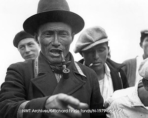 Tłı̨chǫ (Fort Rae Dogrib Band at the time) leader, likely Headman Kwatizo, is seen in a treaty suit, a uniform with gold braid and brass buttons that was replaced every three years as one of the terms of Treaty 11. Richard Finnie/NWT Archives