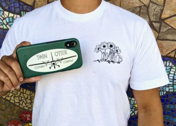 A Twin Otter Clothing company shirt and sticker
