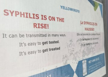 A poster encourages people in downtown Yellowknife to get tested for syphilis. Sarah Pruys/Cabin Radio