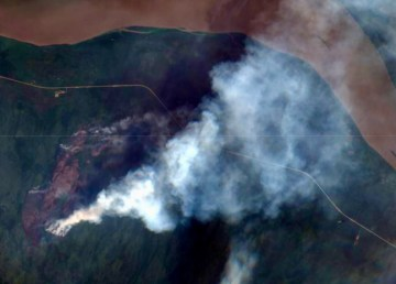 A satellite image from Saturday, July 10, shows smoke from fire FS-015 south of Highway 1