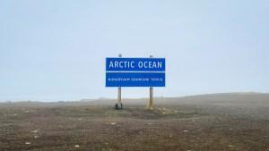 Photo of the Arctic Ocean sign. Luisa Esteban/ Cabin Radio.