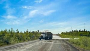 Truck spraying water on the road in Inuvik. Luisa Esteban/ Cabin Radio.