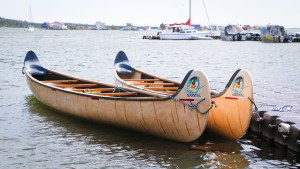 Voyageur Canoes from Narwhal Adventures used on the Intergenerational Voyageur Canoe Tour. Luisa Esteban/ Cabin Radio.