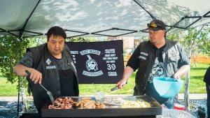 Roger Kunuk (left) and Scott Yuill (right) cook breakfast on July 25, 2021