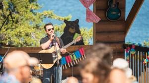Abe Drennan performing on the Cabin Radio stage at Folk on the Rocks 2021. Sarah Pruys/ Cabin Radio.