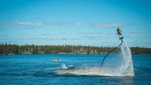 Flyboarding over Long lake. Sarah Pruys/ Cabin Radio.