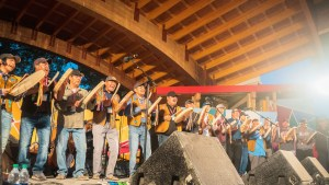 Yellowknives Dene Drummers performing on the main stage at Folk on the Rocks 2021. Sarah Pruys/ Cabin Radio.