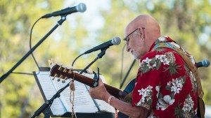 Jim Taylor performing on the Beer Gardens stage at Folk on the Rocks 2021. Sarah Pruys/ Cabin Radio.
