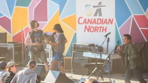 Quantum Haze performing on the main stage at Folk on the Rocks 2021. Sarah Pruys/ Cabin Radio.