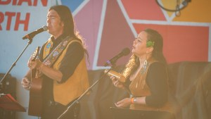 Jay Gilday and Leela Gilday performing on the main stage at Folk on the Rocks. Sarah Pruys/ Cabin Radio.