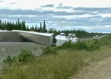 A semi truck on its side on Highway 3 on July 3, 2021