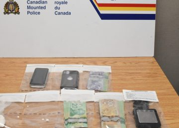 An RCMP photo of the drugs, cash, and cell phones siezed during an arrest on August 18, 2021 in Yellowknife.