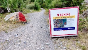 A sign warns users of Tin Can Hill about nearby work relate to the Con Mine reclamation project
