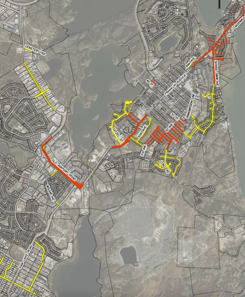 A City of Yellowknife image shows roads (surveyed in yellow, unsurveyed in red) to be acquired from the GNWT