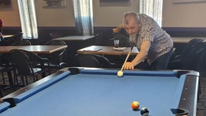 Roman 'Ron' Rosnawski playing pool in a submitted photo.