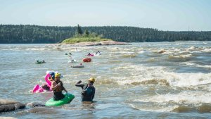 The pool toy race at the Mountain Portage rapids during Slave River Paddlefest in August 2021. Sarah Pruys/Cabin Radio