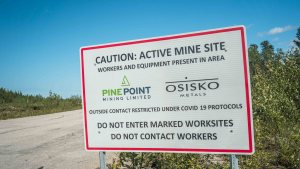Osisko Metals' Pine Point project sign in July 2021. Sarah Pruys/Cabin Radio